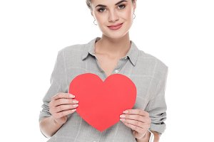 girl holding red paper heart