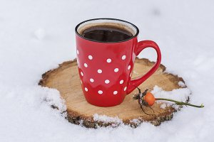black coffee in a red ceramic mug