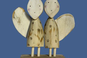 two wooden angels. primitive art