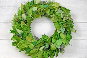 Green Leaf Wreath on White Wood