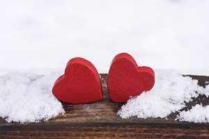 two red wooden hearts