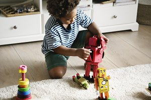Black boy playing robot at home