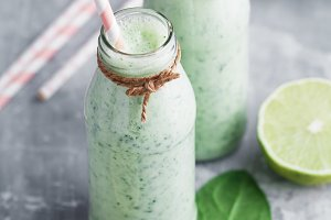 Two spinach smoothies with lime