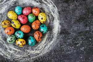 Easter eggs on a black background, E