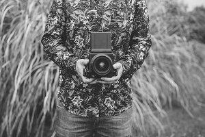 Crop man with film camera