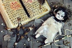 Scary doll and pentagram