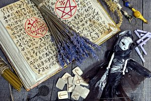Magic book and witch doll