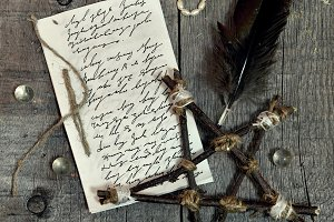 The letter and pentagram