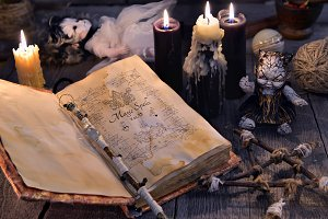 Scary dolls, candles and magic book