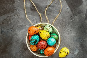 Easter colored eggs on a dark backgr