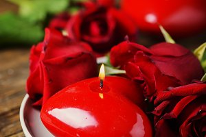 Red candles and roses