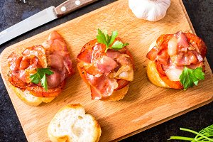Tapas with fried bacon