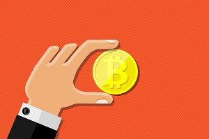 Human hand holding bitcoin