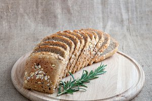 sliced ​​whole wheat bread and thyme
