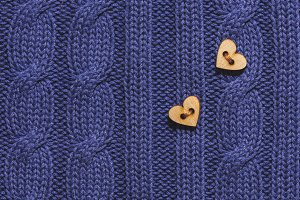 wool sweater and heart button