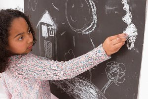 Child drawing on the blackboard