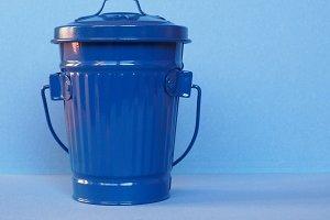 blue litter bin with copy space