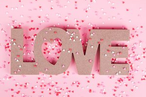 the word love with heart sprinkles
