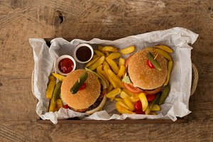Hamburgers in a wooden tray