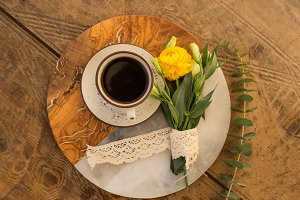 Black coffee and yellow ranunculus