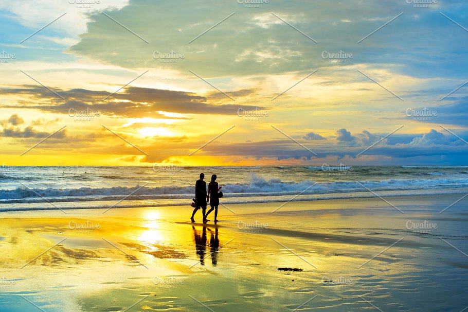 Couple Walking By The Tropical Beach