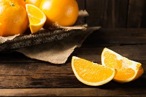 Fresh ripe oranges and slices of oranges