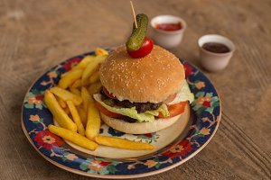 hamburger with french fries in plate