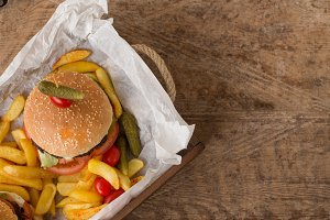 Hamburger with french fries in woode