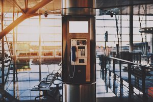 Modern payphone in airport terminal