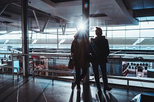 Silhouette of two women in airport