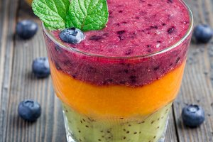 Triple smoothie in glass: kiwi mint, mandarin apricot and strawberry blueberry, square format