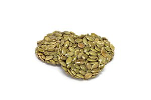 Korean traditional sweet snacks with pumpkin seeds, isolated on white
