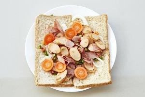 Sliced bread sandwich with pork ham