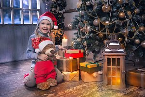 Happy baby near a Christmas tree