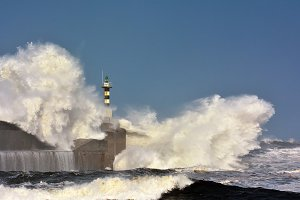 Stormy wave over lighthouse