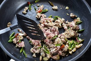 Stir-fried pork with basil leaves In