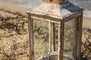 Rustic lantern with candle and seash
