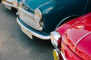 Crop fragments of retro cars in row