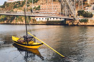 Typical Porto bridge with boat