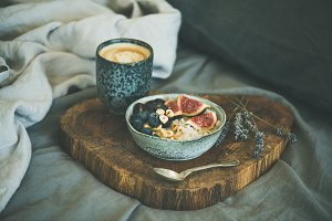 Rice coconut porridge and cup of coffee in bed