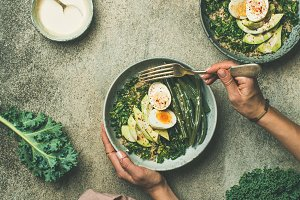 Quinoa, kale, beans, avocado, egg bowls flat-lay, top view