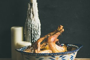 Roasted whole chicken for Christmas, black wall background, squaare crop