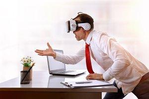 Businessman catching virtual image