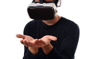 Man with vr glasses looking at hands