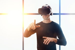 Man with vr glasses window front