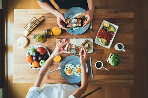 Hipsters taking photo of breakfast