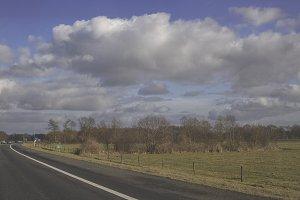 Cloudscape above a road