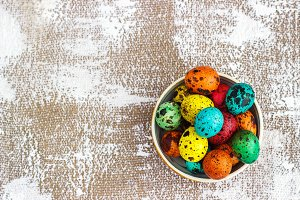 Colored easter eggs on a light canva