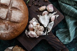 bread and garlic on wooden board