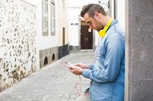 Man listening to music with mobile